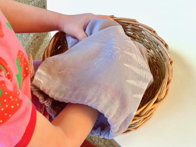 Geometric solids in Montessori stereognostic bag at How we Montessori