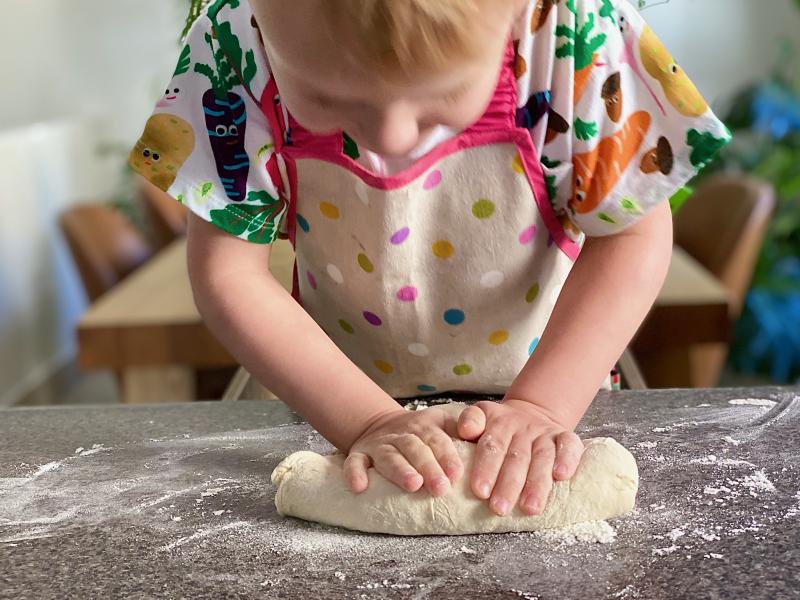 Kneading bread at How we Montessori