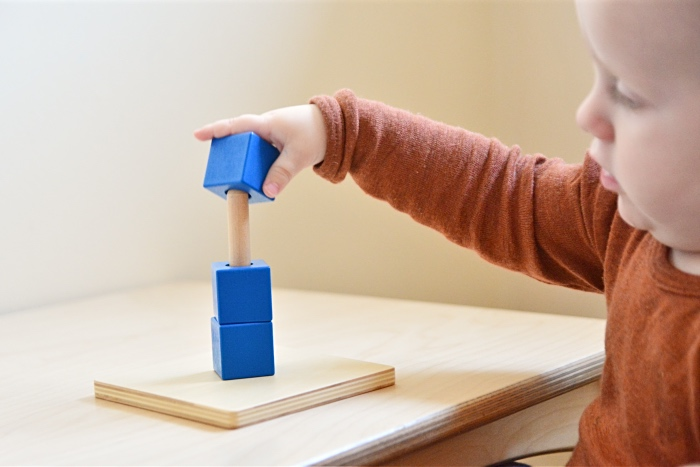 Cubes on a vertical dowel at How we Montessori