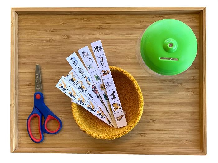 Cutting strips scissor exercises at How we Montessori