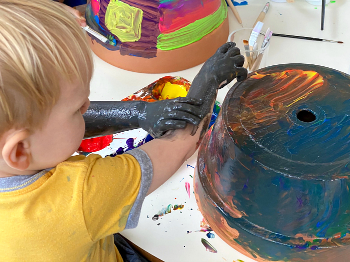 Painting garden pots at How we Montessori