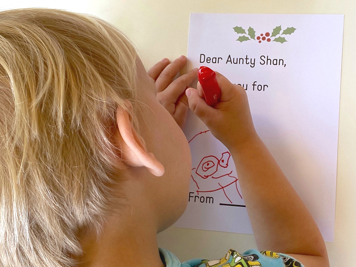 Otto writing thank you note at How we Montessori Christmas thank you letter