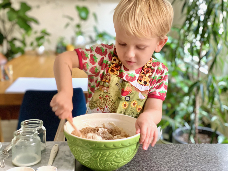 Cracking eggs at How we Montessori baking with kids banana muffins