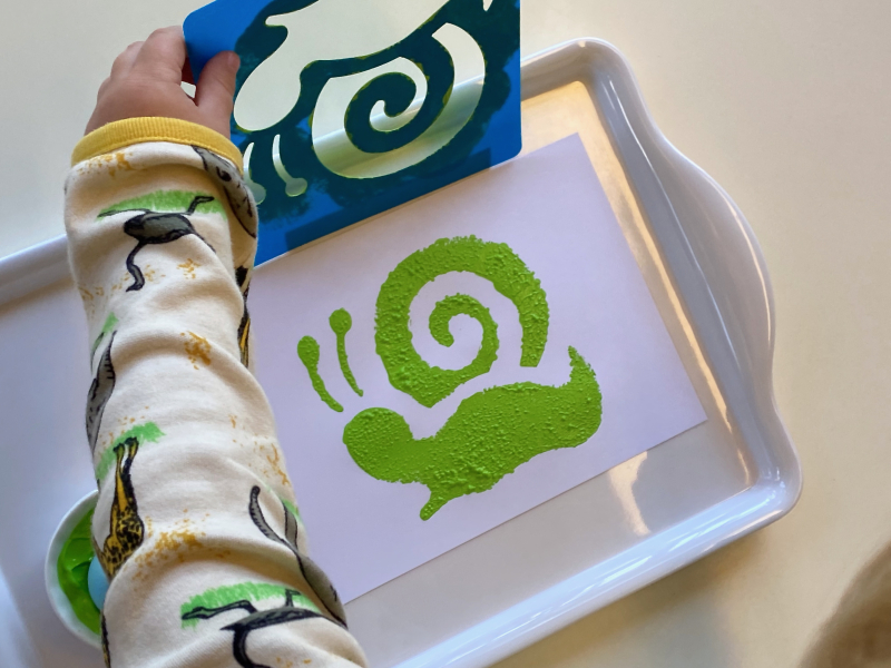Snail stencil with paint and sponge at How we Montessori