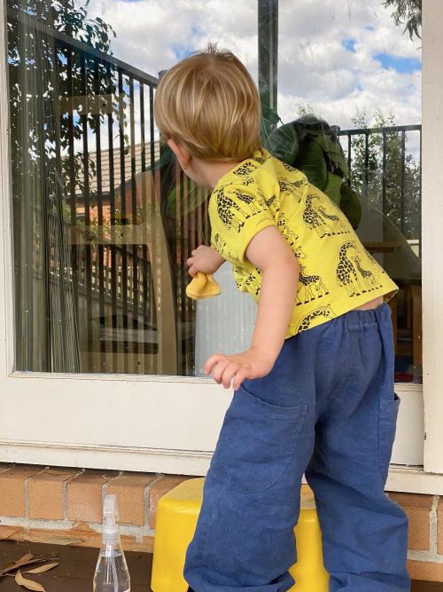 Montessori practical life window washing for three year old at How we Montessori Sydney
