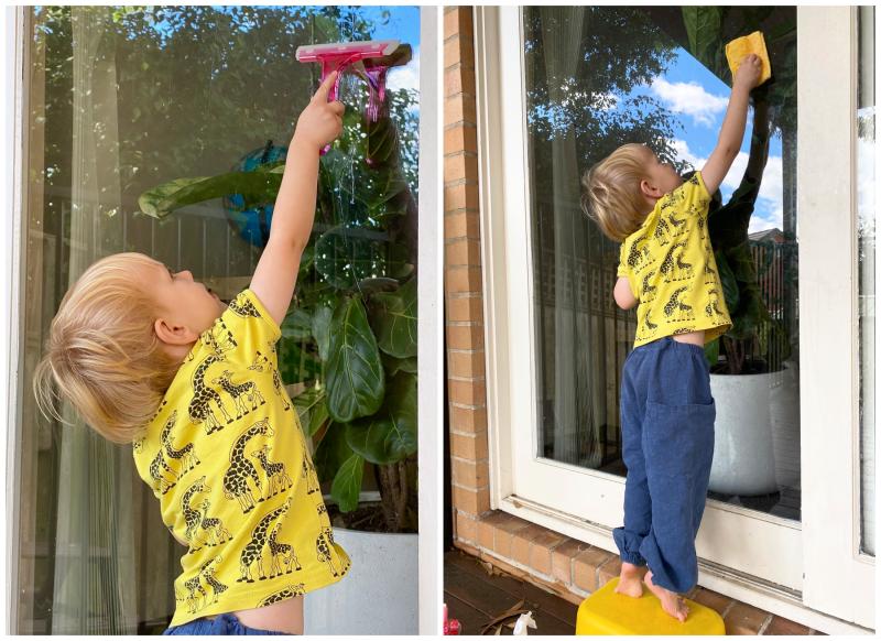 Reaching up Montessori gross motor window washing at How we Montessori