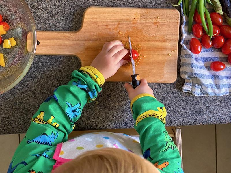 Montessori knife cutting yellow capsicum pepper at How we Montessori