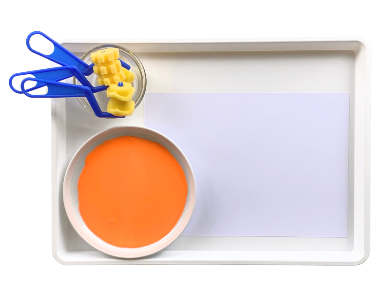 Roller paint activity tray at art at how we Montessori