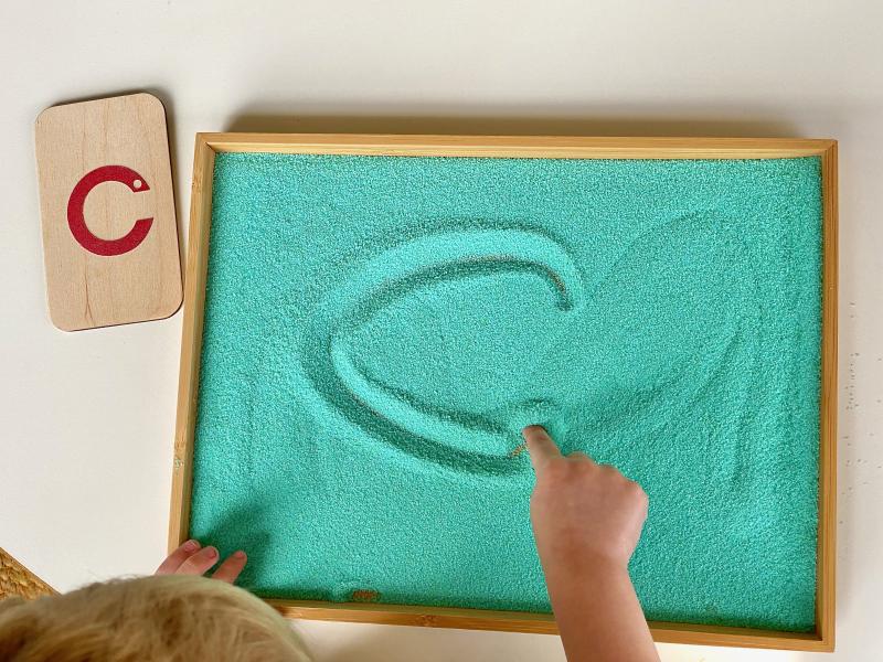 How we montessori sand tray