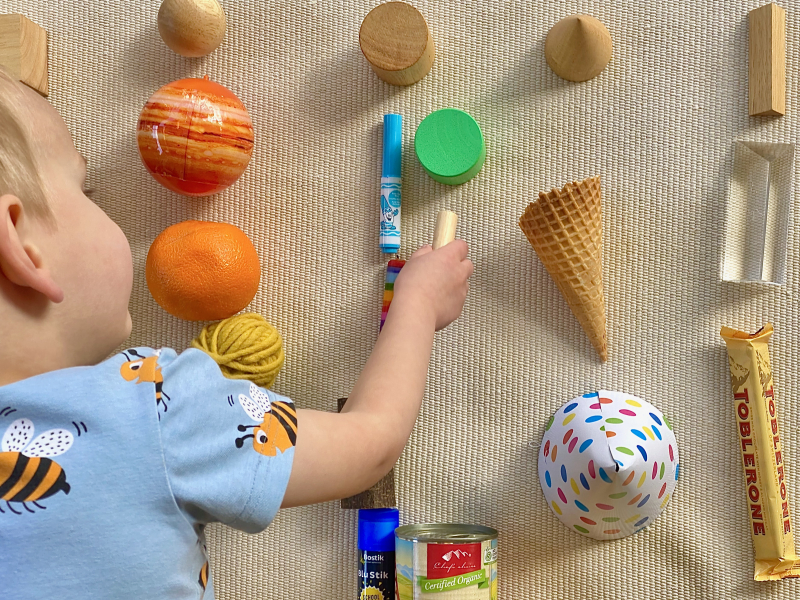 Shape sorting with household objects at How we Montessori