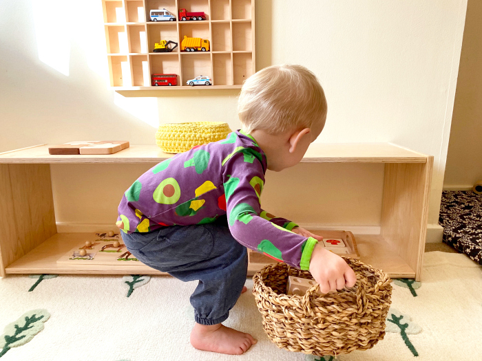Pick up toys at How we Montessori