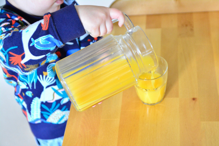 Pouring juice at How we Montessori