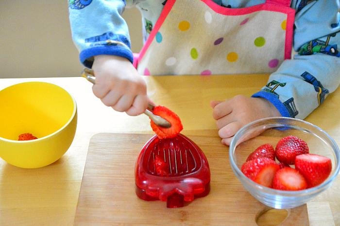 Slice strawberries at How we Montessori