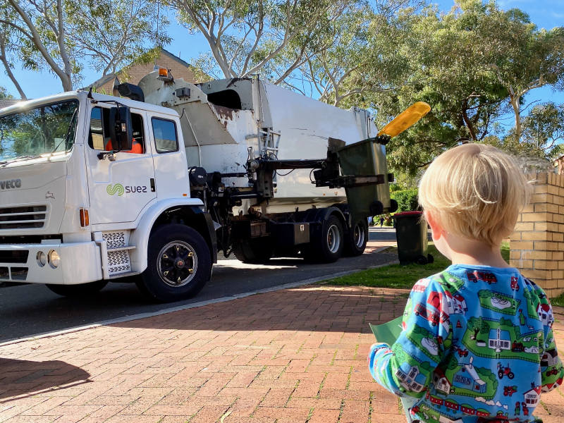 Watching the garbage truck at How we Montessori