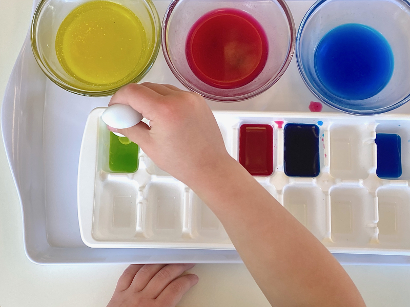 Colour mixing with an ice cube tray and colours with pipette at how we Montessori
