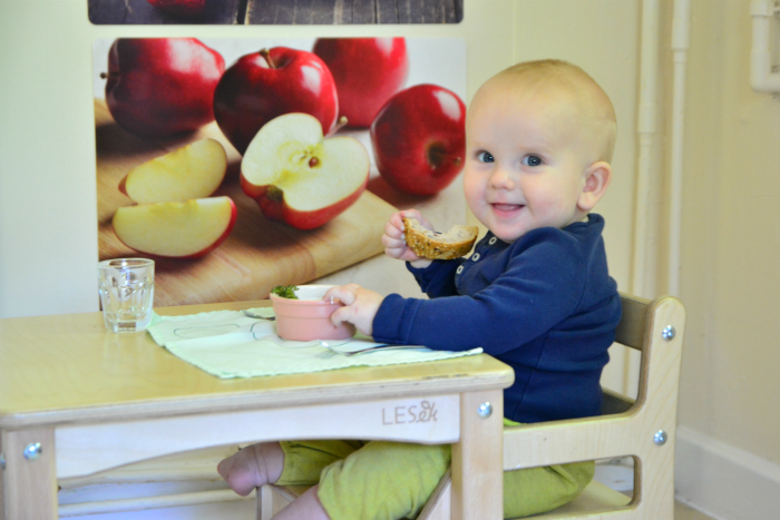 Sitting in the weaning chair at How we Montessori