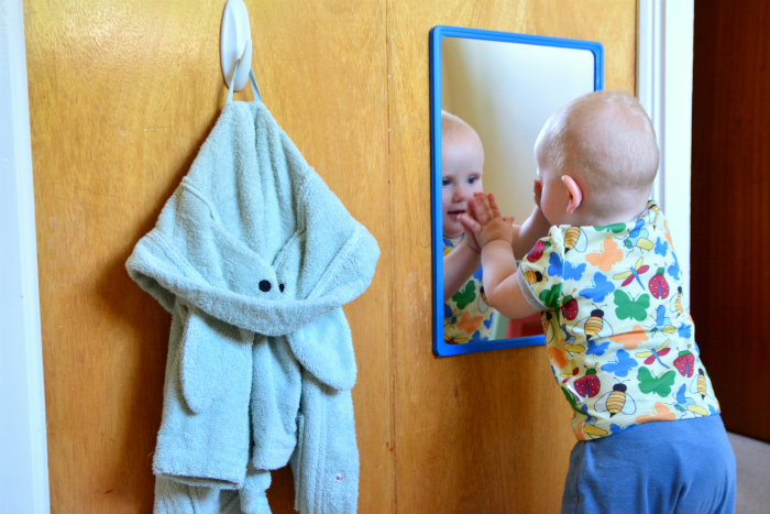 Low mirror low hooks  looking at reflection in mirror at How we Montessori nine months
