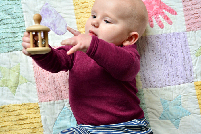 Bell rattle for hand to hand transfer at How we Montessori