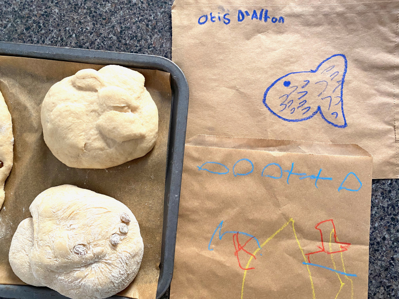 Writing letters in flour at how we Montessori baking bread