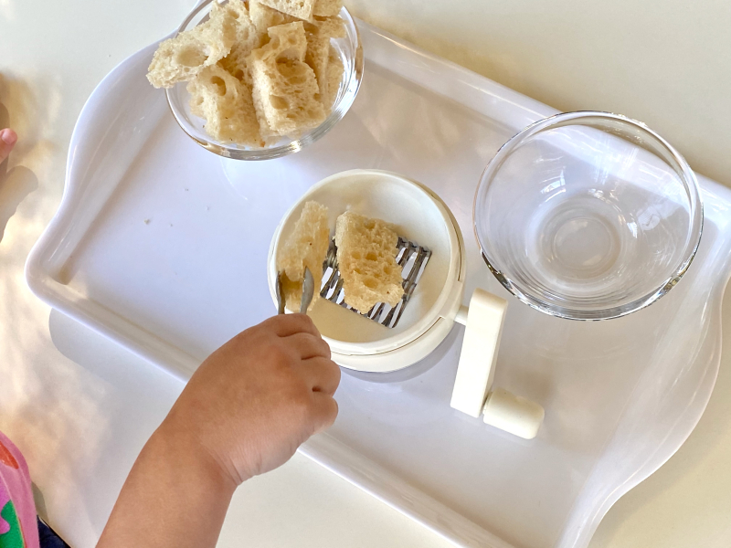 Making bread crumbs with a nut chopper at How we Montessori