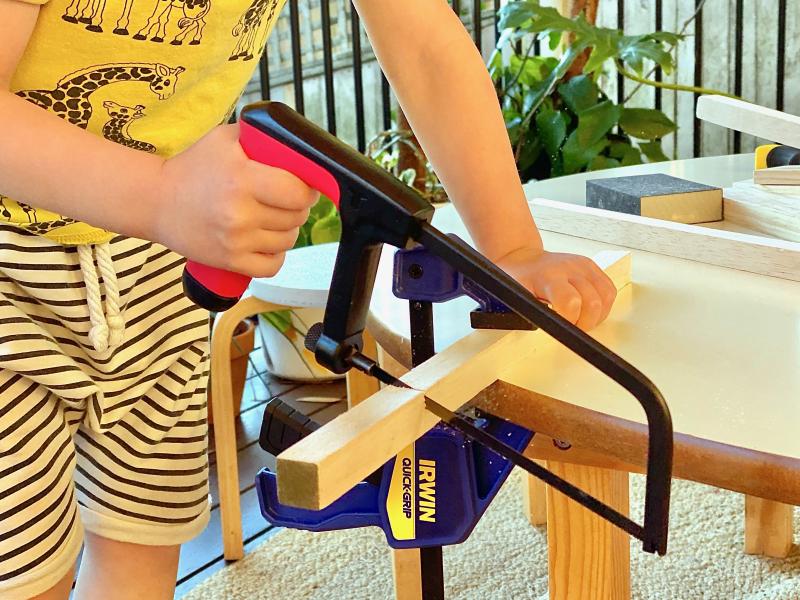Montessori Children's Hand saw at How we Montessori woodworking at three years