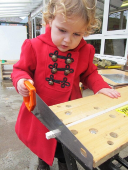 Young+girl+using+handsaw