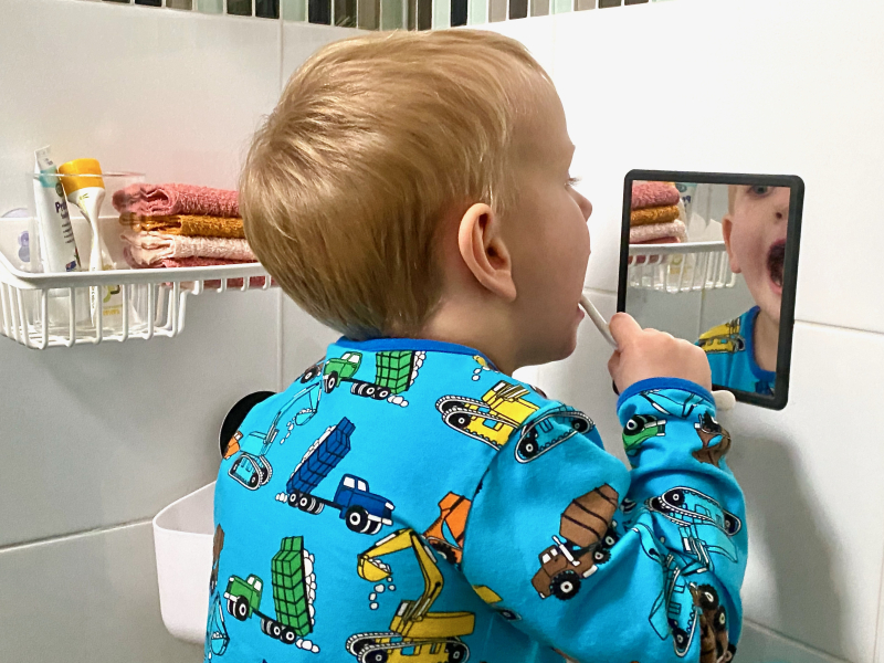 Independent teeth brushing at How we Montessori bathroom three year old