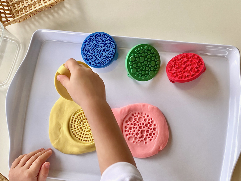 Textured dough stampers at How we Montessori