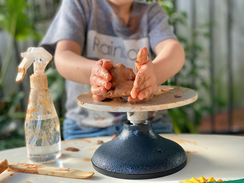 Otto pottery wheel at How we Montessori at three years with clay
