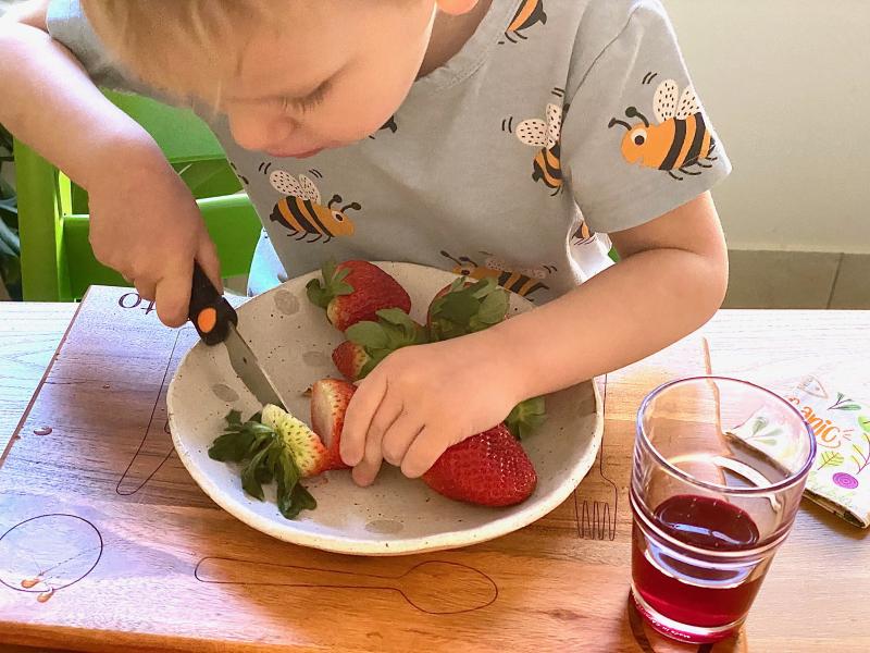 Otto making breakfast at How we Montessori