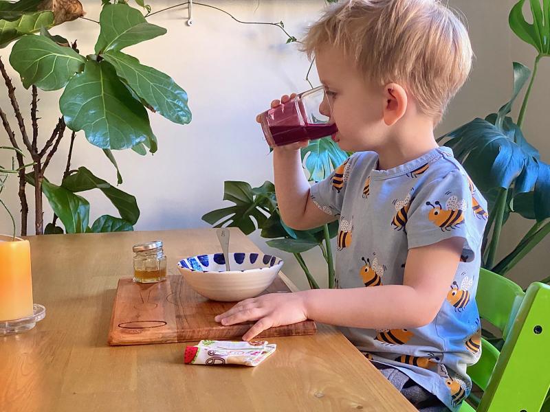 Montessori morning drinking juice at three years (1)