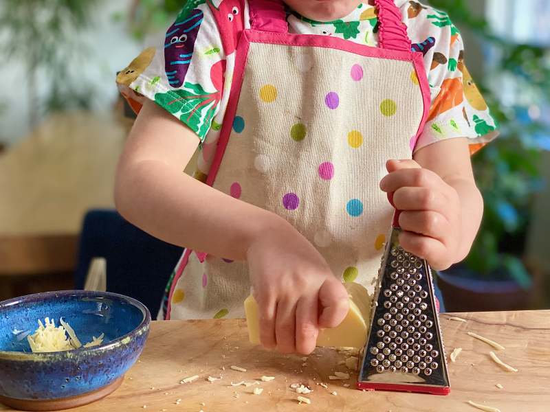 Grating cheese a how we montessori kitchen skills