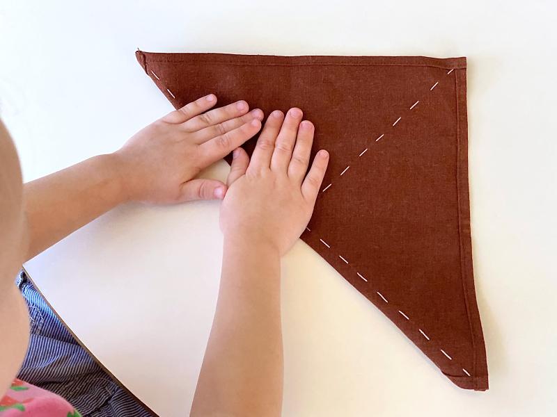 Montessori folding cloths half triangle at How we Montessori