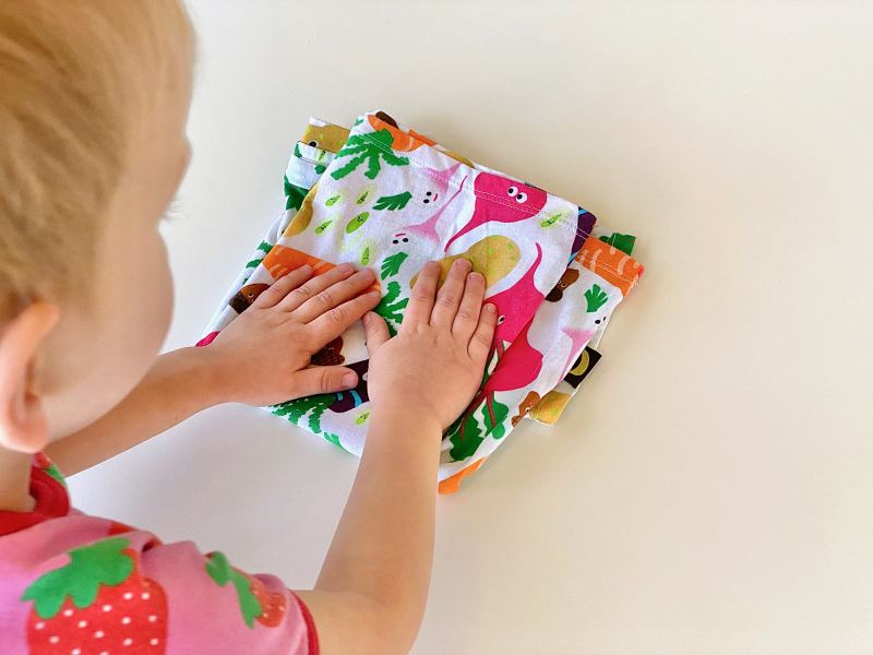 Folding a shirt at three years at How we Montessori