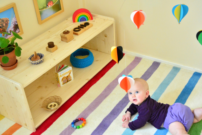 Mobile and Montessori shelves at How we Montessori five months